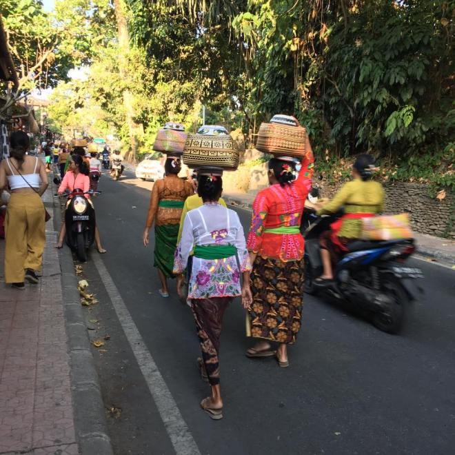 Ladies travelling back from prayer in brightly coloured traditional clothing
